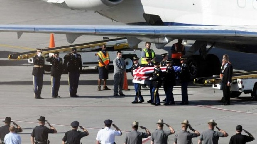 Aug. 2, 2013: The remains of Sgt. Dominick J. Licari, 31 of Frankfort N.Y., arrives at Albany International Airport Friday afternoon in Colonie, N.Y.
