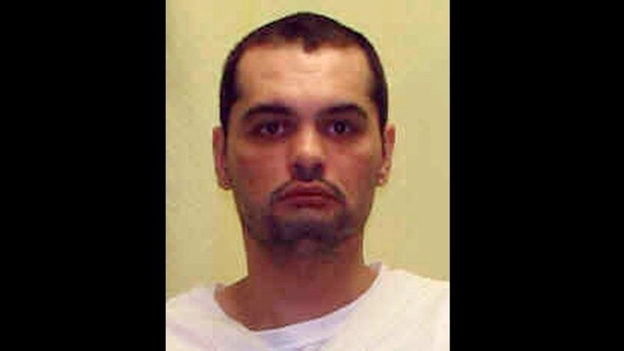 This undated file photo provided by the Ohio Department of Rehabilitation and Correction shows Billy Slagle. Slagle, facing execution Wednesday was found hanged in his cell at the Chillecothe, Ohio Correctional Institution Sunday morning, Aug. 4, 2013.