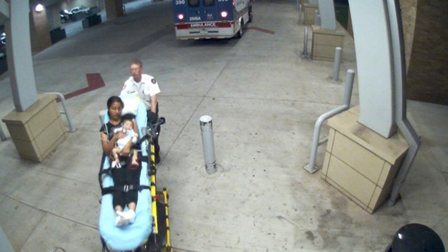 Hospital surveillance footage shows a woman and a two-month-old boy police are looking for.