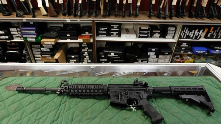 FILE: An AR-15 style rifle is displayed at a gun shop in Aurora, Colo.