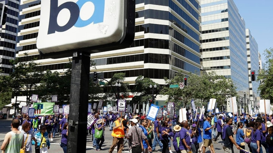 July 1, 2013: In this file photo, striking Bay Area Rapid Transit workers picket as they close the intersection of 14th & Broadway on Min downtown Oakland, Calif.