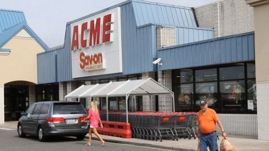 Aug. 8, 2013: Shoppers walk outside an Acme store on Route 9 in Little Egg Harbor, N.J., where one of the winning lottery tickets in the $448 million Powerball drawing was sold.