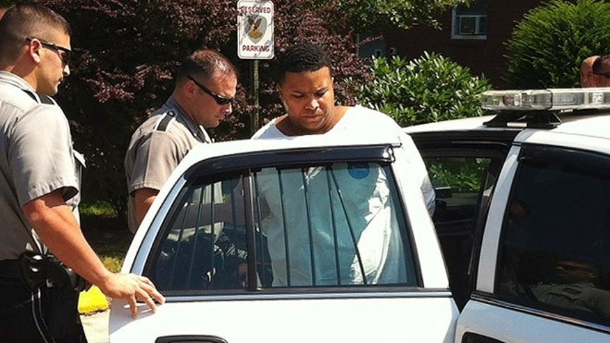 Aug. 12, 2013: Daniel Rodriguez is put into a squad car outside police headquarters in Johnston, R.I.