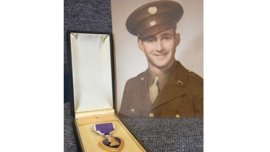 This photo provided by Goodwill Industries in Buffalo, N.Y., shows Pvt. James Roland and the Purple Heart medal he earned serving in World War II.