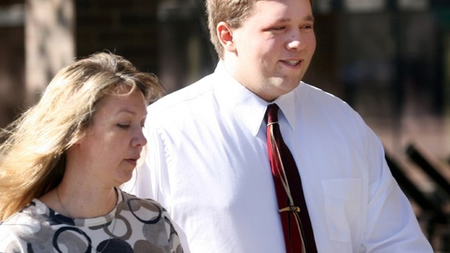 FILE: Roy High School bomb plot suspect Joshua Kyler Hoggan, 16, right, walks out of the 2nd District Juvenile Court in Ogden with his mother, Janice Hoggan.