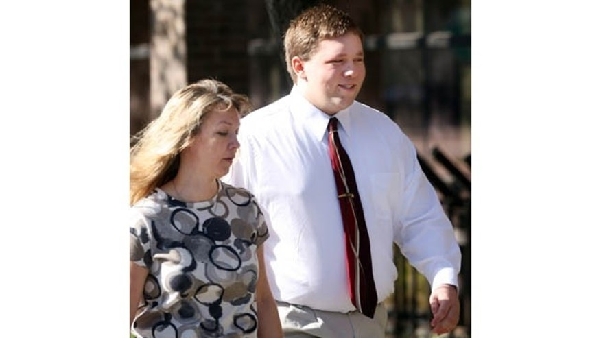 FILE - In this April 4, 2011 file photo, Roy High School bomb plot suspect Joshua Kyler Hoggan, 16, right, walks out of the 2nd District Juvenile Court in Ogden with his mother, Janice Hoggan. (AP Photo)
