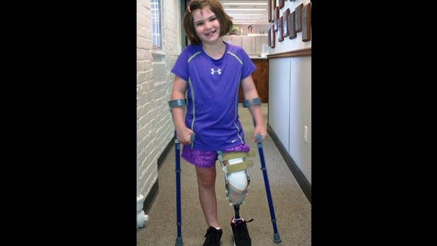 Aug. 15, 2013: This Richard family photo shows Jane Richard, 7, who lost part of her left leg in the Boston Marathon bombings on April 15, 2013, walking on a prosthetic leg in Boston.