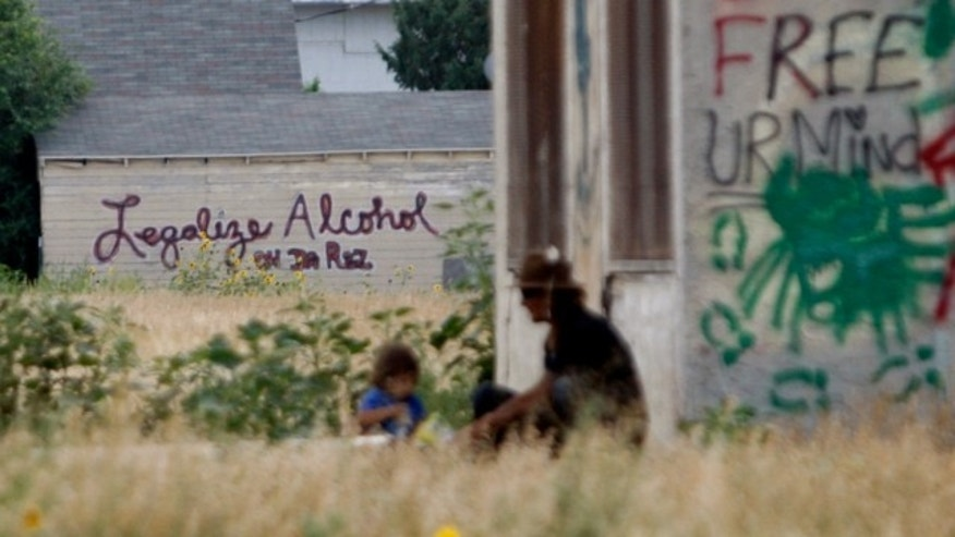 Aug. 13, 2013: Graffiti supporting the legalization of alcohol on the Pine Ridge Indian Reservation is painted on the side of a building in Whiteclay, Neb., indicates support for the legalization of alcohol on the Pine Ridge Indian Reservation,