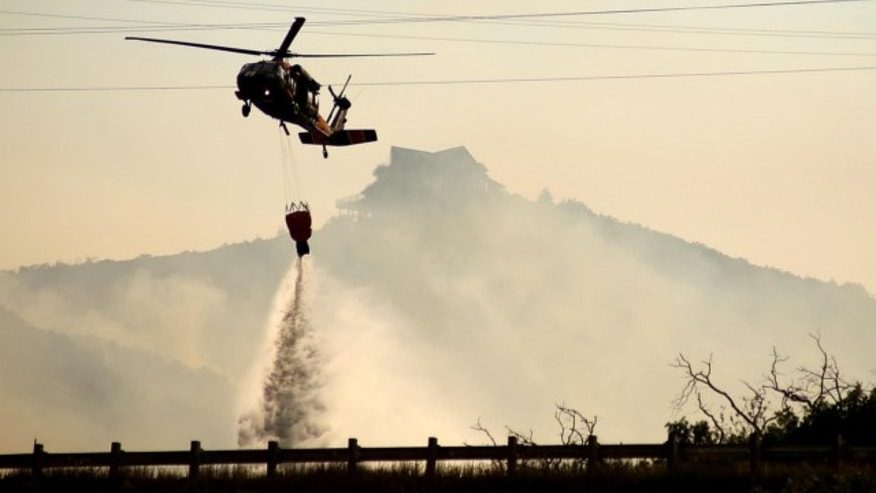 Aug. 14, 2013: A helicopter drops fire water on the Rockport fire in Rockport, Summit County.