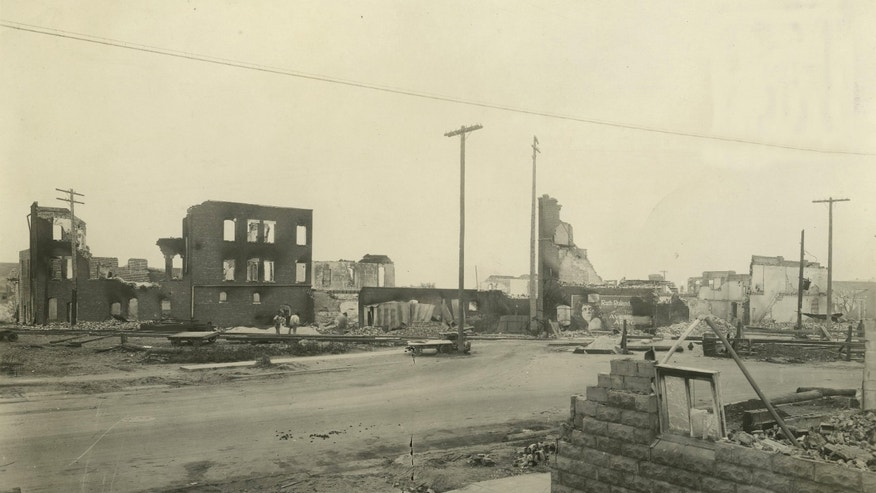 In this June 1, 1921, photo provided by the Tulsa Historical Society are businesses that were burned and looted in Tulsa's Greenwood District during race riots that left 300 blacks dead and hundreds more wounded in a span of 18 hours. Wyatt Tate Brady, who arrived in Tulsa in 1890, had become a man of means and influence by the time the territory became Oklahoma in 1907.