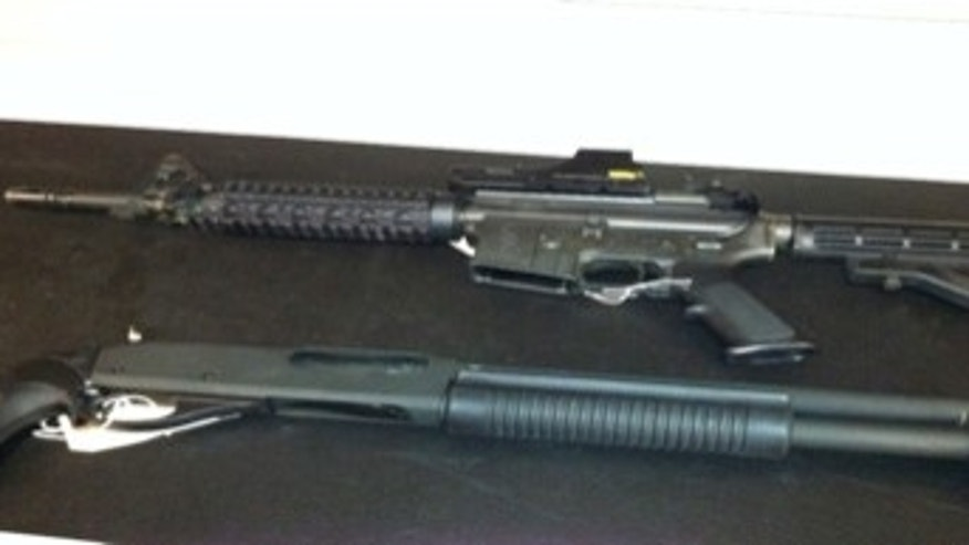 A Colt M-16 and Remington 870 shotgun are pictured in this photo provided by the FBI.
