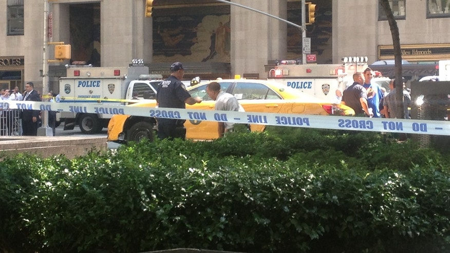 Aug. 20, 2013: A taxi driver drove onto the sidewalk after hitting a bicyclist in midtown Manhattan, striking multiple people, witnesses say.