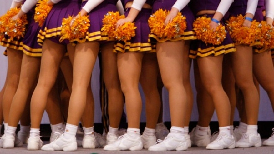 "FILE: March 30, 2008: High school cheerleaders from team ""VIGORS"" perform at the a cheerleading and dance championship in Chiba, east of Tokyo."
