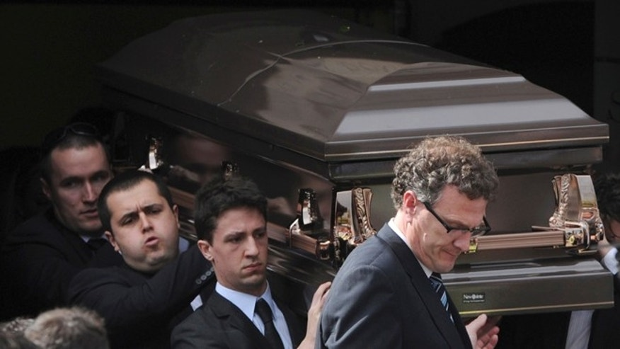 Aug. 28, 2013: Pallbearers carry the coffin of Christopher Lane to the funeral hearse at St. Therese's Church in Melbourne, Australia. Lane died Aug. 16 in Duncan, Oklahoma, and police say three teenagers targeted him at random to break up the monotony of an Oklahoma summer. (AP/AAP Image, Julian Smith)