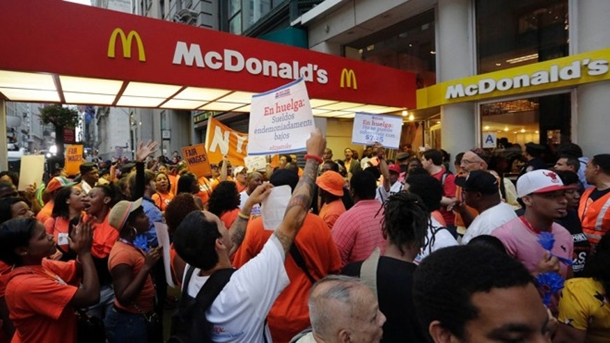Aug. 29, 2013: Protesting fast food workers demonstrate outside a McDonald's restaurant on New York's Fifth Avenue.