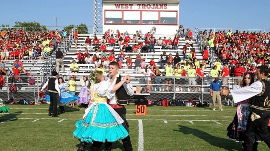 Aug.  29, 2013: The West High School Junior Historian Czech Dancers performs at a morning pep rally in West, Texas.