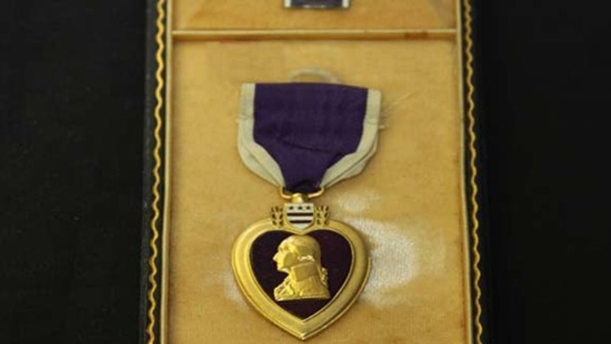 UNDATED: This Purple Heart medal is one of more than 120 military medals, badges and other insignia awaiting return in Missouri.