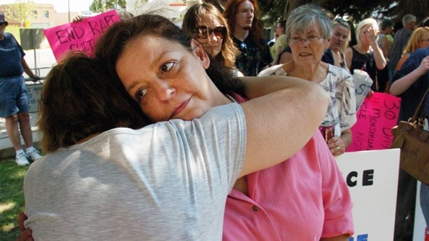 Aug 29, 2013: Auliea Hanlon receives a hug from a supporter during a rally in which protesters called for the resignation of a judge who presided over the trial of a former teacher who raped Hanlon's daughter.