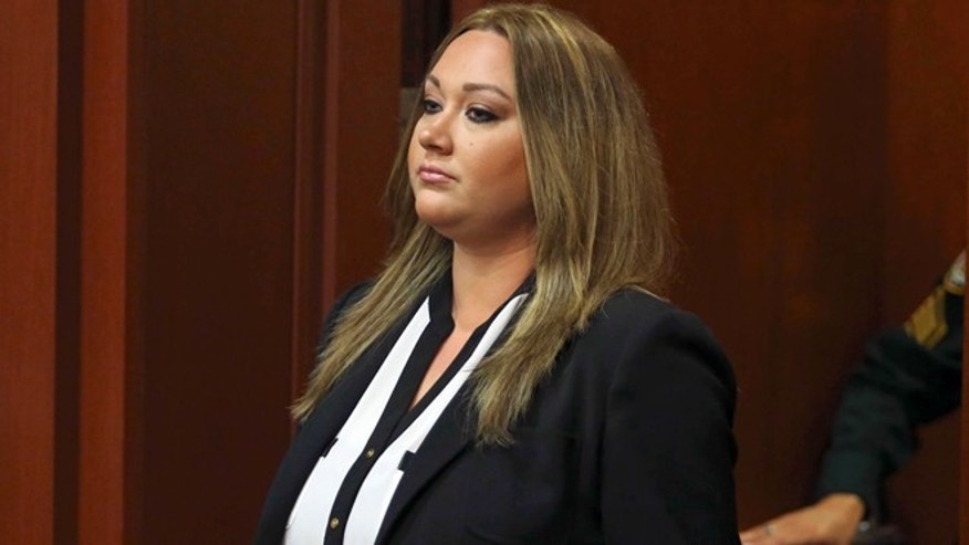 Aug. 28, 2013: Shellie Zimmerman, wife of George Zimmerman, pleads guilty at the Seminole County Courthouse in Sanford, Fla.. Shellie Zimmerman pleaded guilty to a misdemeanor perjury charge for lying during a bail hearing after her husband's arrest, and she was sentenced to a year's probation and 100 hours of community service.