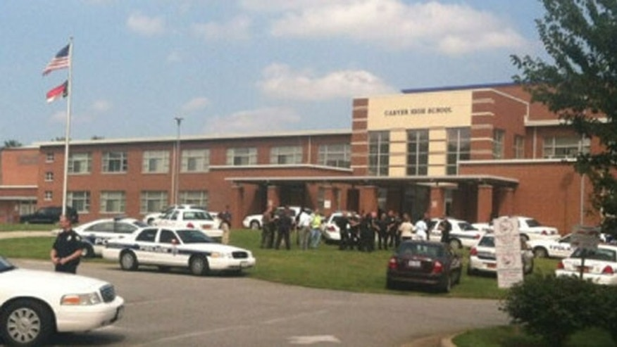Aug 30, 2013: The scene outside Carver High School after reports of shots fired.