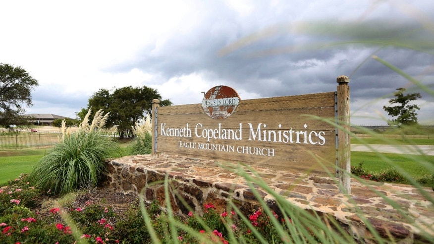 Aug. 27, 2013: This photo shows a sign at the entrance of the Kenneth Copeland Ministries Eagle Mountain Church, in Newark, Texas.