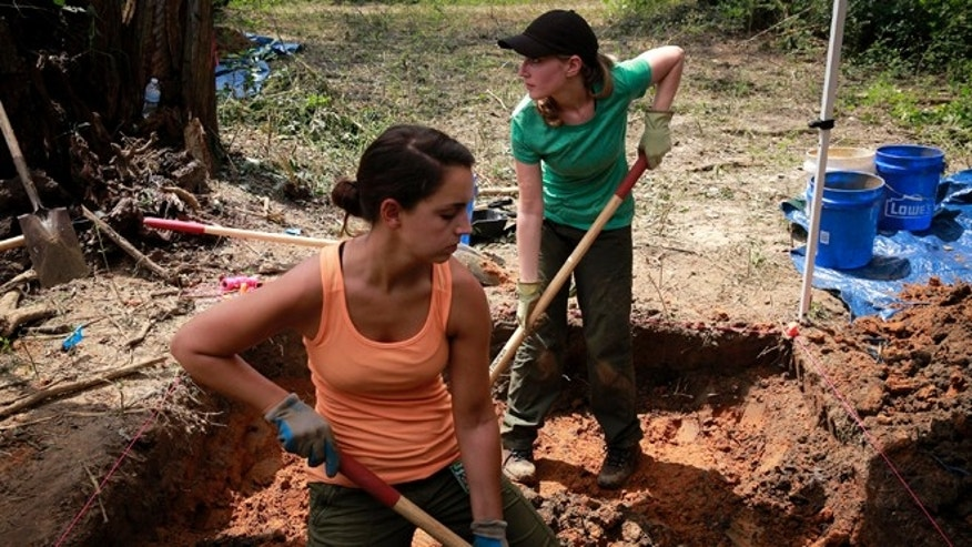 Aug. 31, 2013: University of South Florida masters student Cristina Kelbaugh, left, and PhD student Ashley Maxwell, 27, dig at the Boot Hill cemetery at the closed Arthur G. Dozier School for Boys in Marianna, Fla.