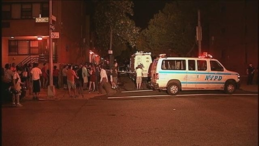 August 31, 2013: A crowd gathers at the scene of the shooting in Brooklyn Sunday evening (MYFOXNY.com)