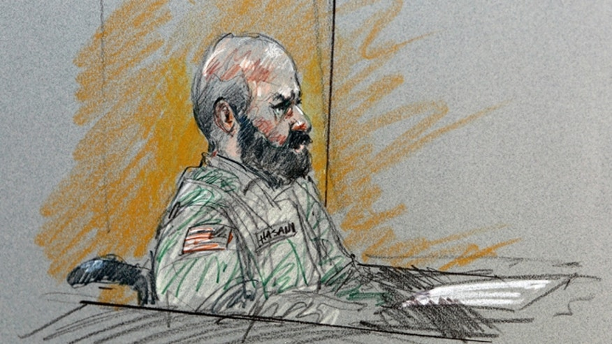 Aug. 6, 2013: In this file courtroom sketch, Maj. Nidal Malik Hasan sits in court for his court-martial in Fort Hood, Texas.