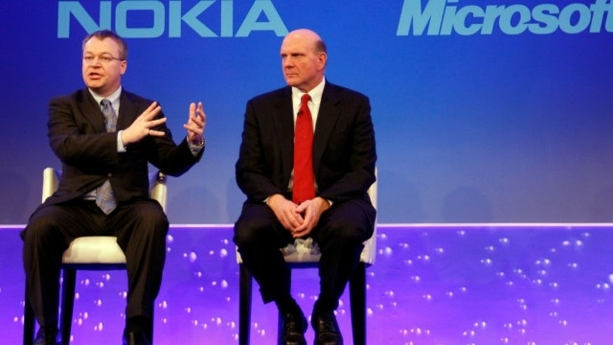 FILE: Feb. 11, 2011: This photo shows Stephen Elop CEO of Nokia, left, with CEO of Microsoft Steve Ballmer, speaking in London, as he announces the strategic partnership with Microsoft.