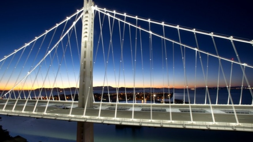 Aug. 29, 2013: In a handout photo provided by the Bay Area Toll Authority, LED lights illuminate the San Francisco-Oakland Bay Bridge's self-anchored suspension in San Francisco.
