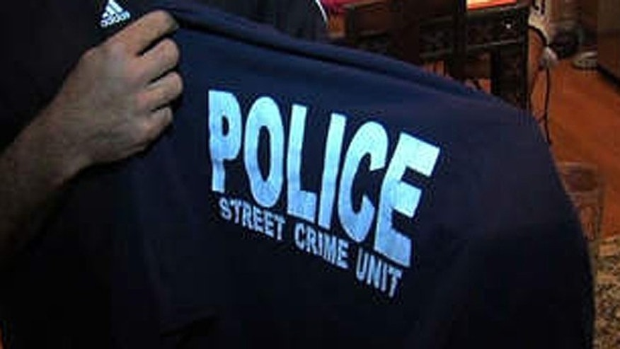 "Christian Jarosz, of Jupiter, Fla., wore this shirt to the Orlando theme park that clearly said ""Police, Street Crime Unit,"" despite the fact that he's not a police officer. Jarosz's brother, who is an NYPD officer, gave him the shirt, he told WPTV.com. (WPTV.com)"