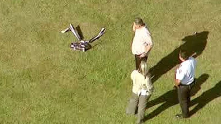 Sept. 5, 2013: In this image taken from video and provided by WABC-TV in New York, investigators stand near a remote controlled toy helicopter that apparently struck and killed a 19-year-old man.
