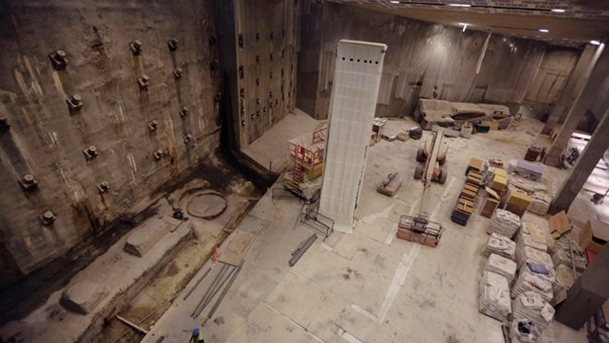 Sept. 6, 2013: The slurry wall, left, part of the World Trade Center's original foundation and the last column removed from the WTC site, center covered in a protective wrap, are seen during a media tour of the National September 11 Memorial and Museum in New York.