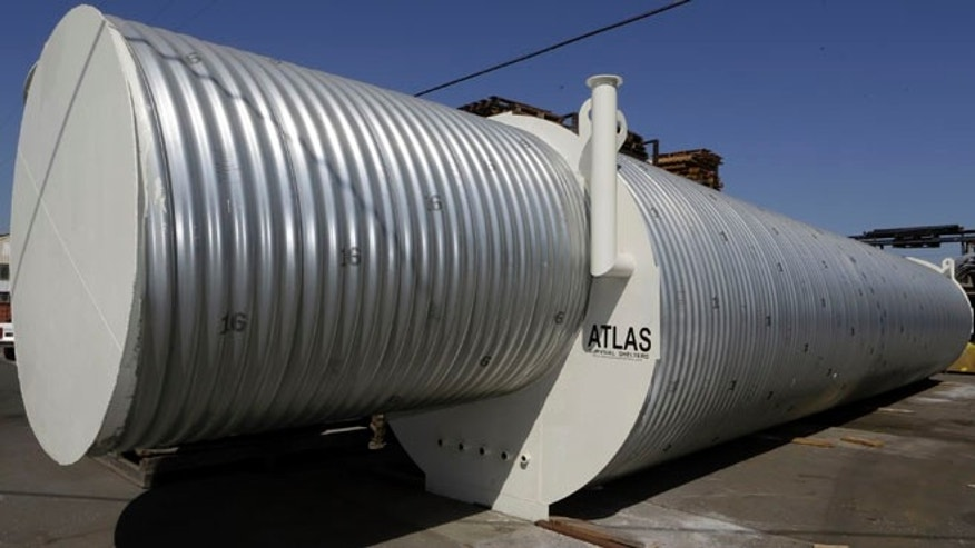 Aug. 12, 2013: In this photo, Atlas Survival Shelters owner Ron Hubbard shows his galvanized corrugated pipe shelters at a plant in Montebello, Calif.