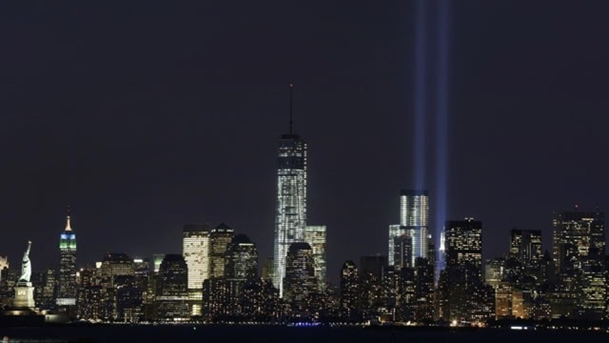 September 9, 2013: The Tribute in Light rises above the lower Manhattan skyline and One World Trade Center, center, in a test of the memorial light display in New York. The twin beams of light will also appear Wednesday, Sept. 11, twelve years after the terrorist attacks of Sept. 11, 2001. (AP Photo)