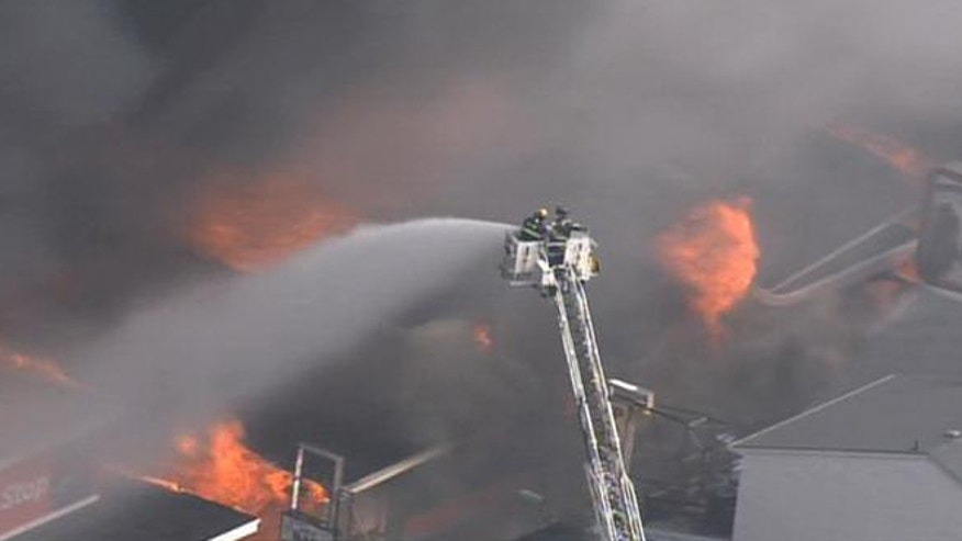 Sept. 12, 2013: Firefighters battle a fire raging along a New Jersey boardwalk.