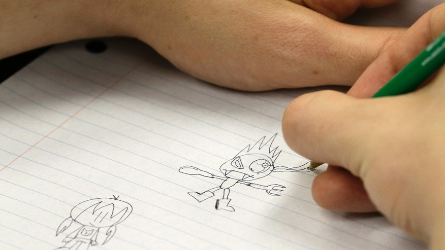 Tony Saylor, 22, draws in a classroom at Eastern Michigan University in Ypsilanti, Mich., Thursday, Sept. 5, 2013. Often, his constant doodling features a 9-year-old character named Viper Girl who, with her pet fox Logan, frequently finds herself battling monsters. Saylor, 22, has even self-published three books of their adventures. For college students with autism and other learning disabilities, its the kind of balancing act that takes place every day - accommodating a disability versus pushing beyond it toward normalcy and a degree that, as for any student these days, is increasingly essential for finding a meaningful career. (AP Photo/Paul Sancya)