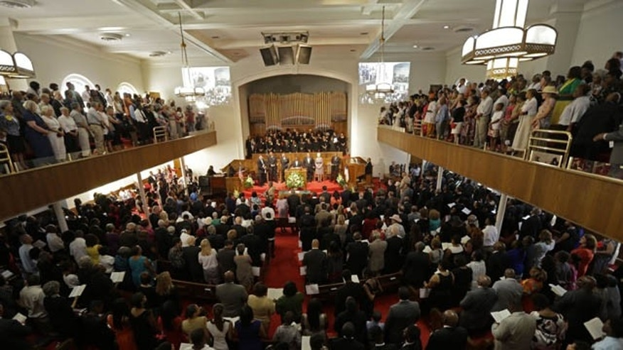 September 15, 2013: The congregation sings at the 16th Street Baptist Church in Birmingham, Ala. The church held a ceremony honoring the memory of the four young girls who were killed by a bomb placed outside the church 50 years ago by members of the Ku Klux Klan. (AP Photo)
