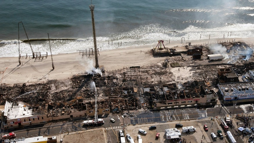 This aerial photo shows aftermath of a massive fire that burned a large portion of the Seaside Park boardwalk, Friday, Sept. 13, 2013, in Seaside Park, N.J. The fire, which apparently started Thursday in an ice cream shop and spread several blocks, hit the recently repaired boardwalk, which was damaged last year by Superstorm Sandy. (AP Photo/The Asbury Park Press, Bob Bielk)