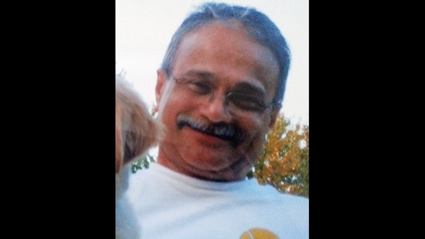 This photo provided by the family of Vishnu Pandit shows the 61-year-old man from North Potomac, Md., who was one of the 12 victims killed in the shooting rampage at the Washington Navy Yard on Monday, Sept. 16, 2013.
