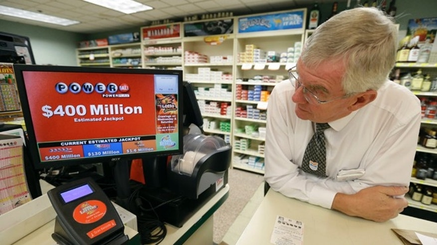 Sept. 17, 2013: Dahl's grocery store manager Don Mark looks at a monitor displaying the estimated jackpot amount for Wednesday's Powerball drawing in Des Moines, Iowa. The giant Powerball jackpots keep coming, with the latest $400 million prize ranking among the largest ever. But soon, lottery players could see even more huge jackpots as organizers of the Mega Millions lottery move ahead with plans to revamp the game and attract more players. (AP/Charlie Neibergall)