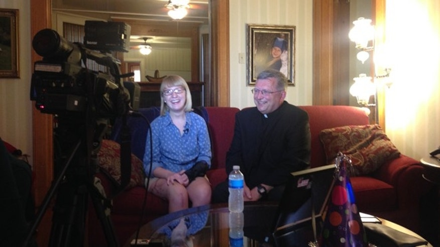 Katie Lentz reunites with Father Patrick Dowling.
