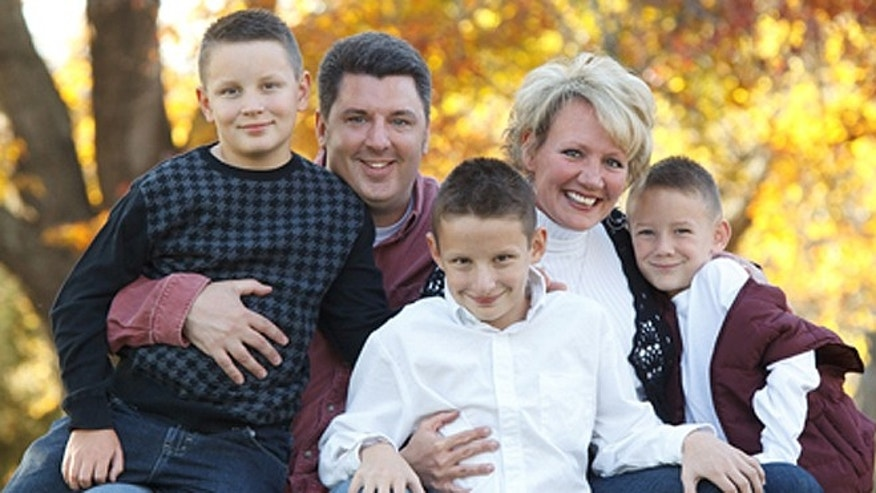 Erin Stevens, founder of Strip Church in Nashville, appears in an undated photograph with her husband, Todd, and the couple's three children. Stevens said launching the ministry has been her 'greatest accomplishment' aside from raising Elijah, 13; Daniel, 10; and Levi, 7. (Courtesy: Erin Stevens)