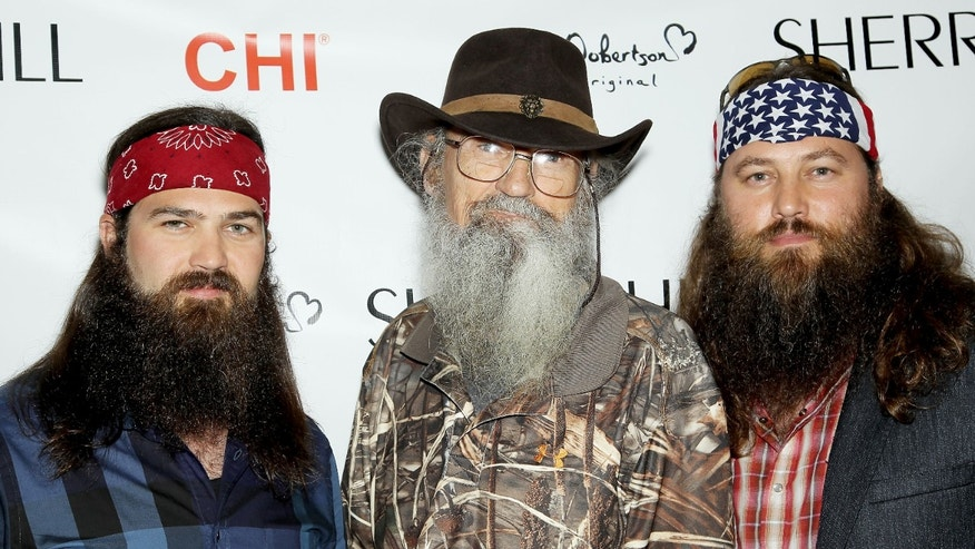 "This image released by Starpix shows TV personalities,from left, Jep Robertson, Si Robertson, and Willie Robertson, from the A&E series ""Duck Dynasty,"" at the Sherri Hill Fashion Show, Monday, Sept. 9, 2013, in New York. The Robertsons attended  to support Willie's daughter Sadie Robertson who modeled several outfits for the show. (AP Photo/Starpix, Marion Curtis)"