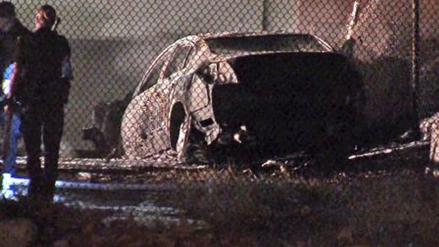 Sept. 28, 2013: This image taken from video provided by ABC-TV shows officials at the site of a fiery single-vehicle crash that killed 5 people in Burbank, Calif.