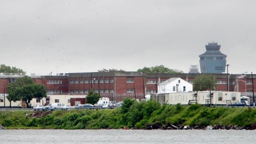 In this May 17, 2011 file photo, the East River flows past New York Citys Rikers Island correctional facility. The operating of Rikers Island consumes a large chunk of the New York City jail systems budget. It costs nearly as much to jail a city inmate for a year as it does to pay for four years tuition at a private college.