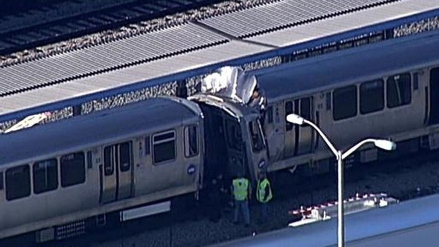 Sept. 30, 2013: Two trains after they collided at the Harlem station in Chicago.