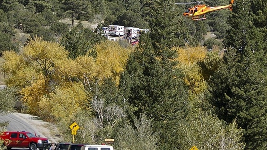 Sept. 30, 2013: A Flight for Life Helicopter rises above backed up traffic  as emergency personnel work to aid hikers trapped after a rock slide on the trail to Agnes Vaille Falls.