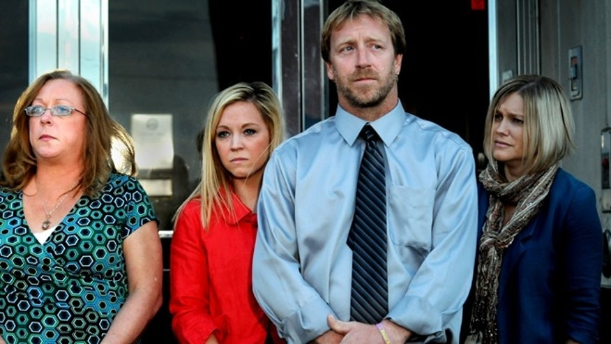 Oct. 2, 2013: From left, Kira Steger's mother, Marcie Steger, sister Keri Anne Steger, father Jay Steger and victim's advocate Jen Mallenger listen to their lawyer speak to the media at the Ramsey County Courthouse in St. Paul, Minn.