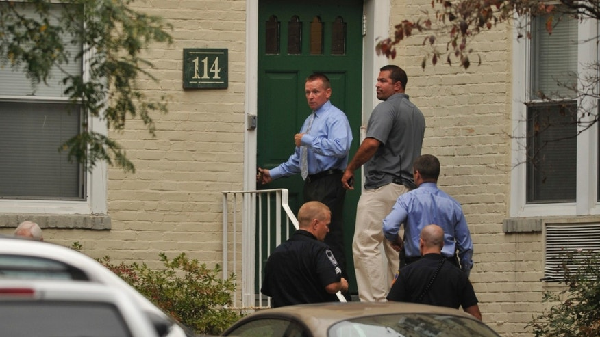 Law enforcement from local, state and federal jurisdictions investigate the residence of Miriam Carey in Stamford, Conn. Thursday, Oct. 3, 2013.  Law-enforcement authorities have identified Carey, 34, as the woman who, with a 1-year-old child in her car, led Secret Service and police on a harrowing chase in Washington from the White House past the Capitol Thursday, attempting to penetrate the security barriers at both national landmarks before she was shot to death, police said. The child survived. (AP Photo/The Stamford Advocate, Jason Rearick) MANDATORY CREDIT: STAMFORD ADVOCATE